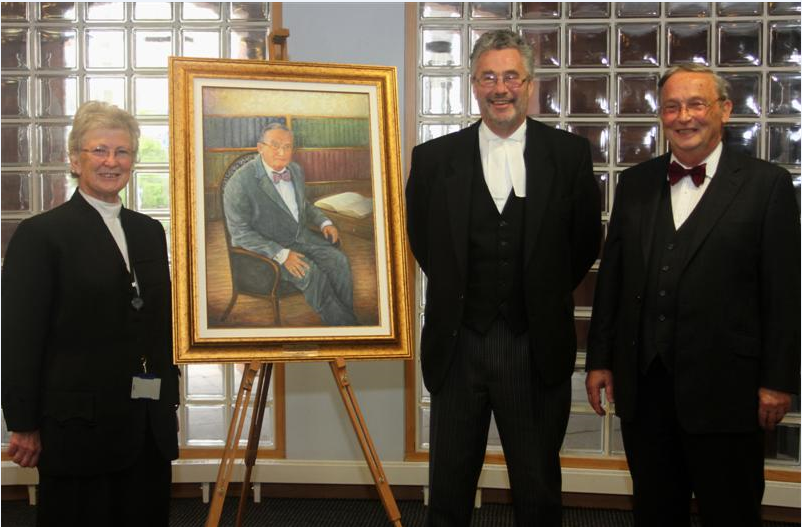 Professor Bates and his portrait are pictured with the President of Tynwald the Hon Clare Christian and the Speaker of the House