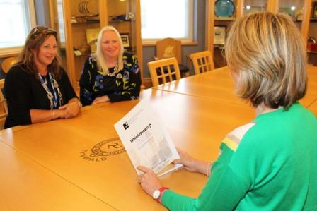 Mrs Kerry Sharpe MLC (holding Whistleblowing document) with Ms Halford-Hall and Ms Julie Edge MHK